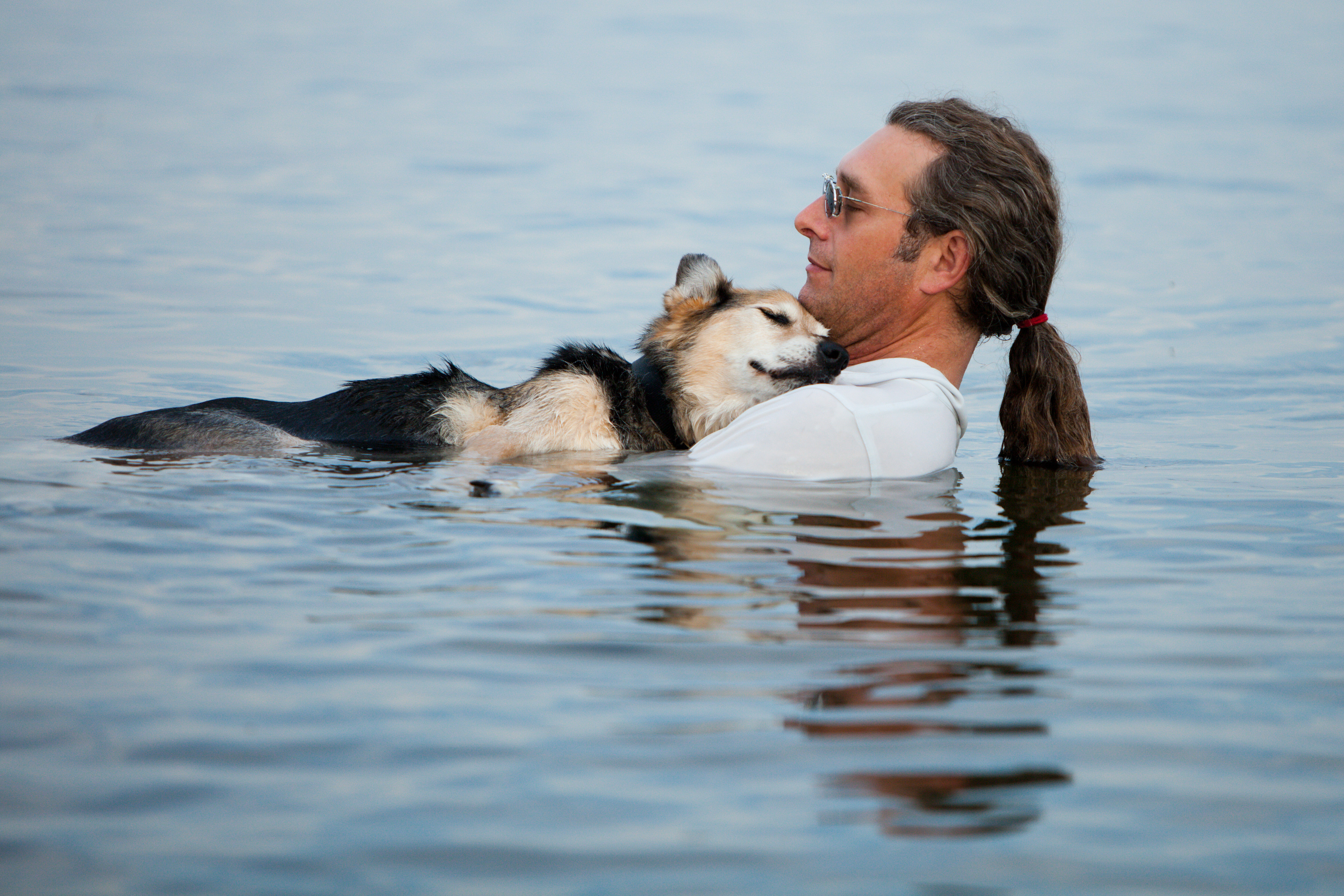 Owner and dog in the water